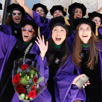 Medical Students Smile at 2012 Graduation Ceremony