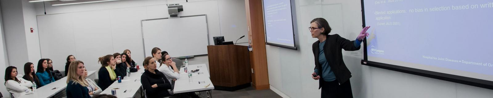 Professor Gives Powerpoint Presentation to Class
