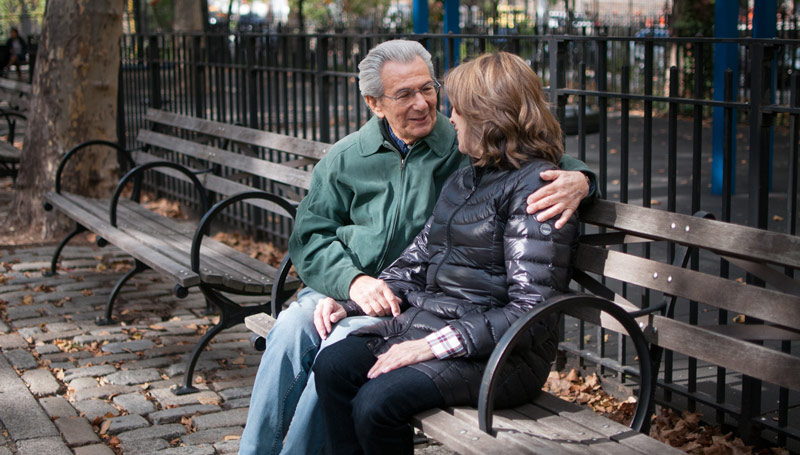 Couple Talking on a Park Bench