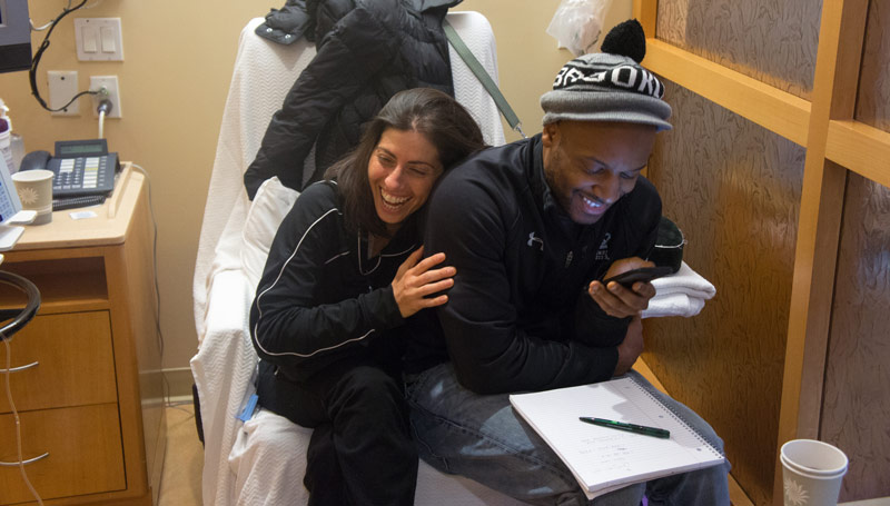 Man and Woman Laughing in an Exam Room