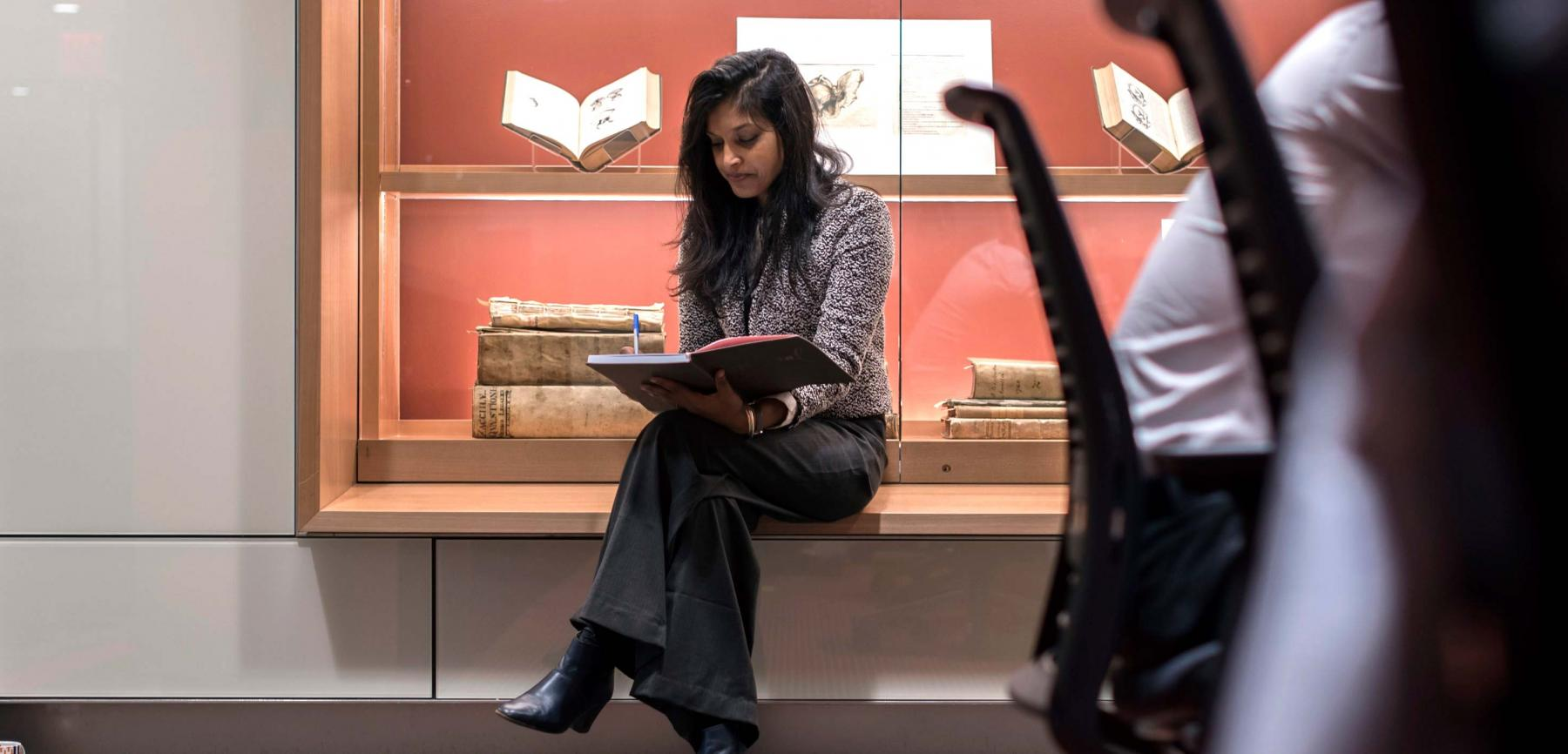 Postdoctoral Fellow Bhama Ramkhelawon Reads a Book