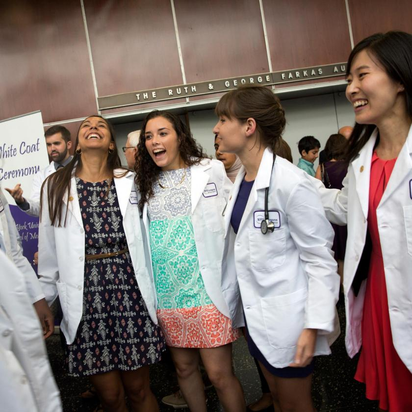 NYU School of Medicine Students Smiling at White Coat Ceremony