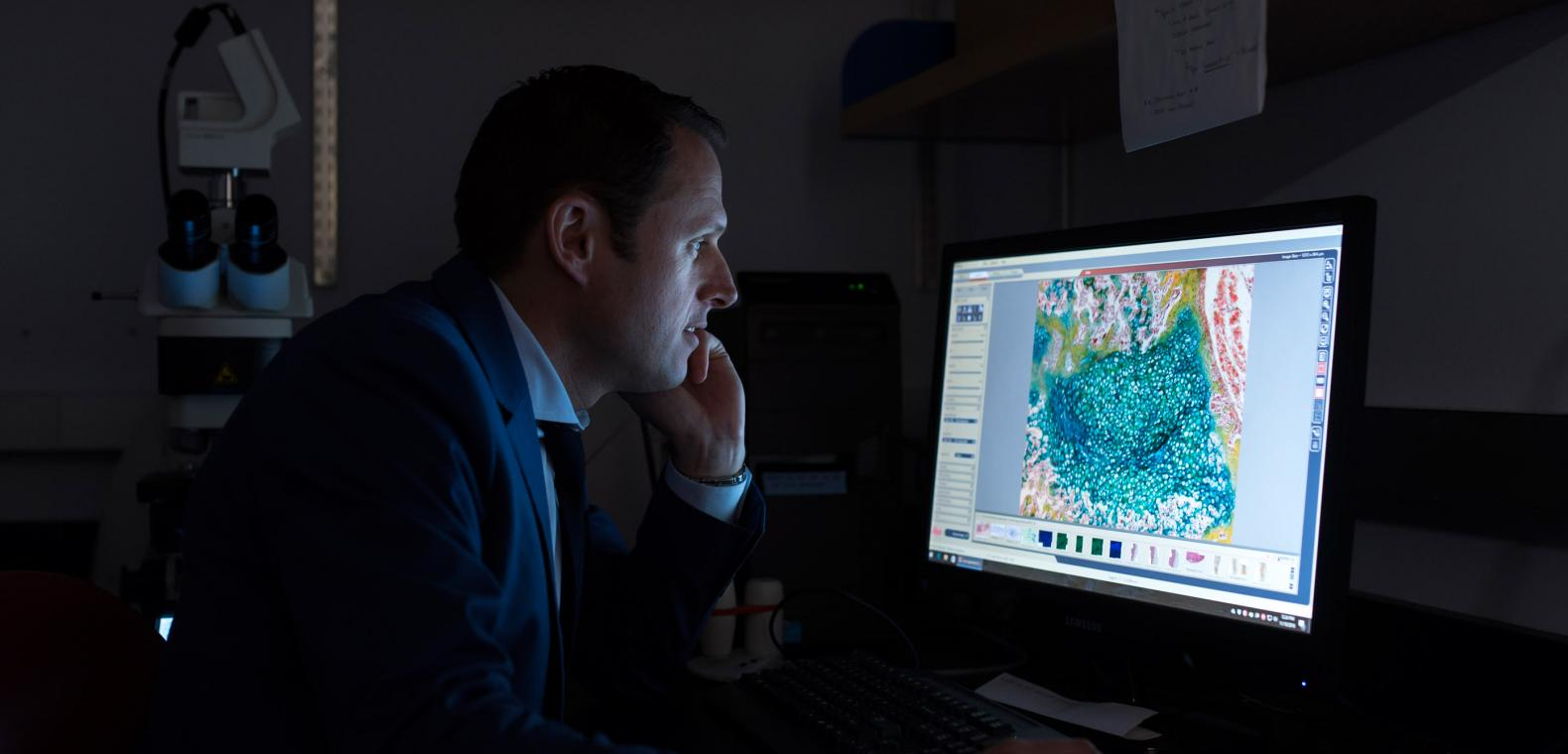 Researcher Looks at Cellular Images on Computer