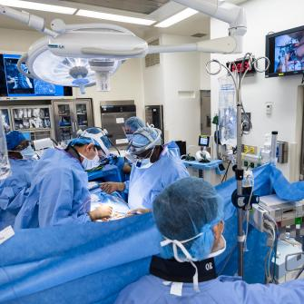 Neurosurgeon Dr. Anthony Frempong-Boadu and Colleagues Perform Surgery in Operating Room