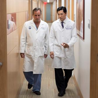 Neurosurgeon Dr. John Golfinos and Neuro-oncologist Dr. Andrew Chi Walk Down Hallway
