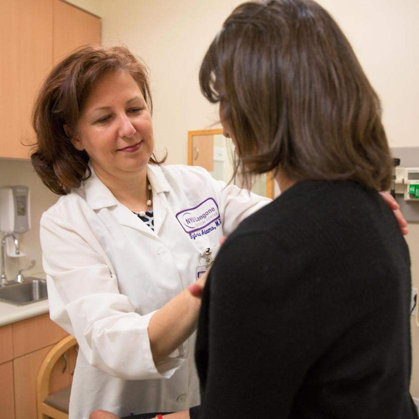 Dr. Sylvia Adams, MD, medical oncologists, examines a patient.