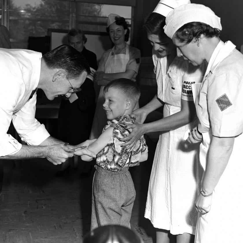 Black and White Image of Nurses and Doctor Treating Young Boy