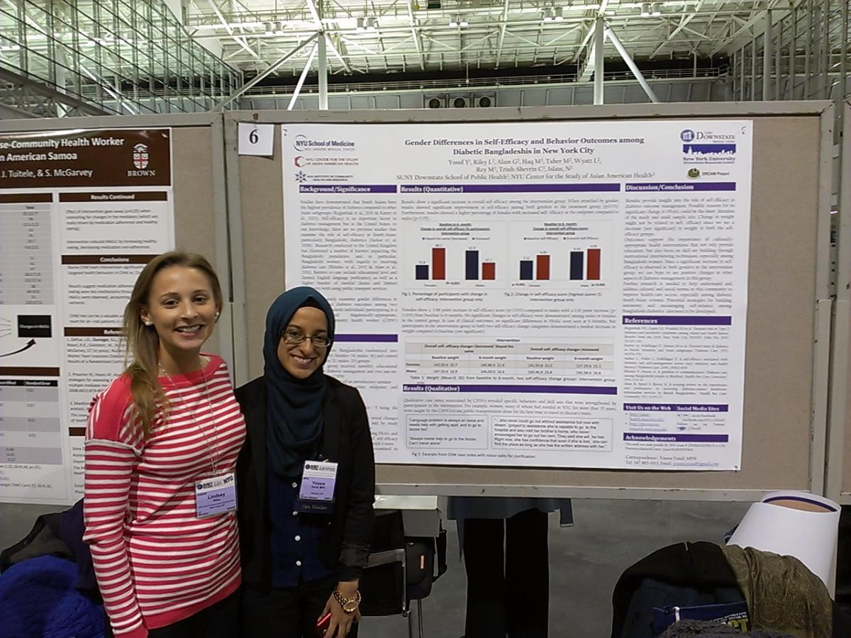Lindsey Riley, DREAM Project Coordinator and Yousra Yusuf, DREAM intern at a poster session.