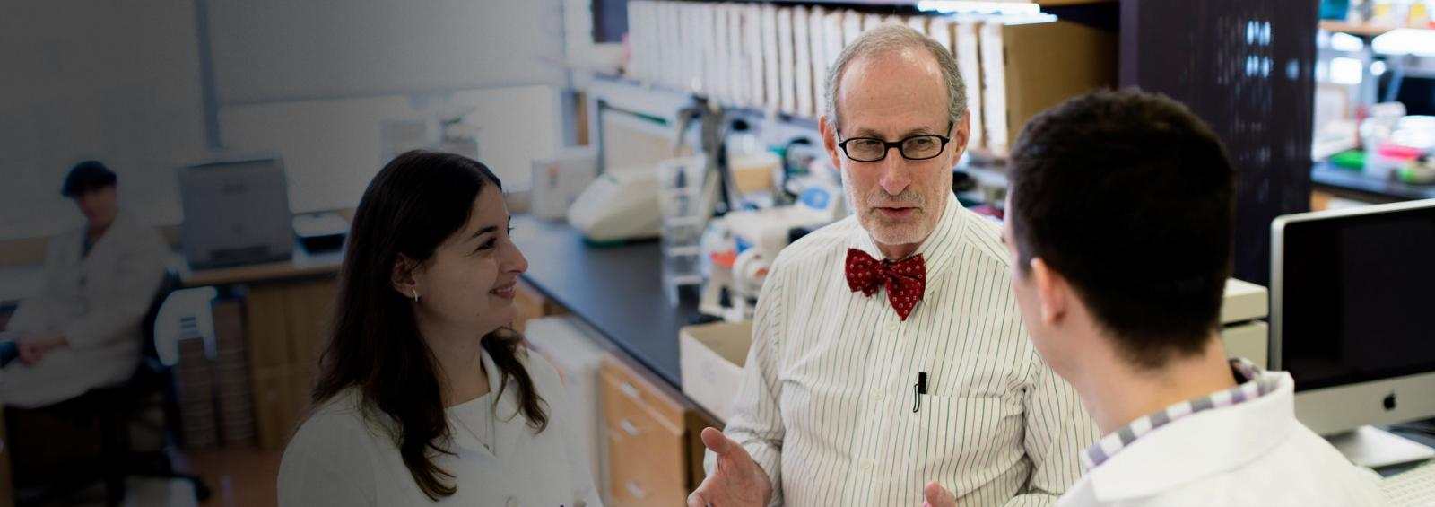 Dr. Jeffrey Weber and Students Chatting in Lab