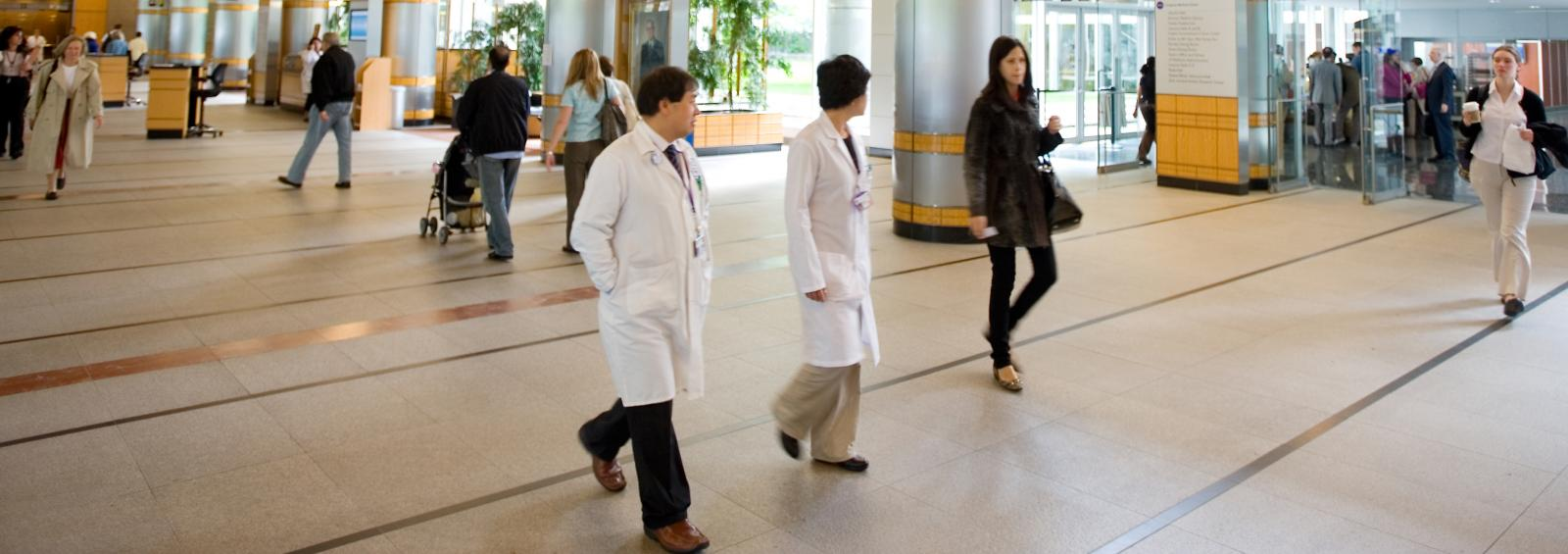 People Walk Through Tisch Hospital Lobby
