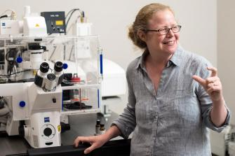 Pathologist Dr. Susan Schwab with Microscope