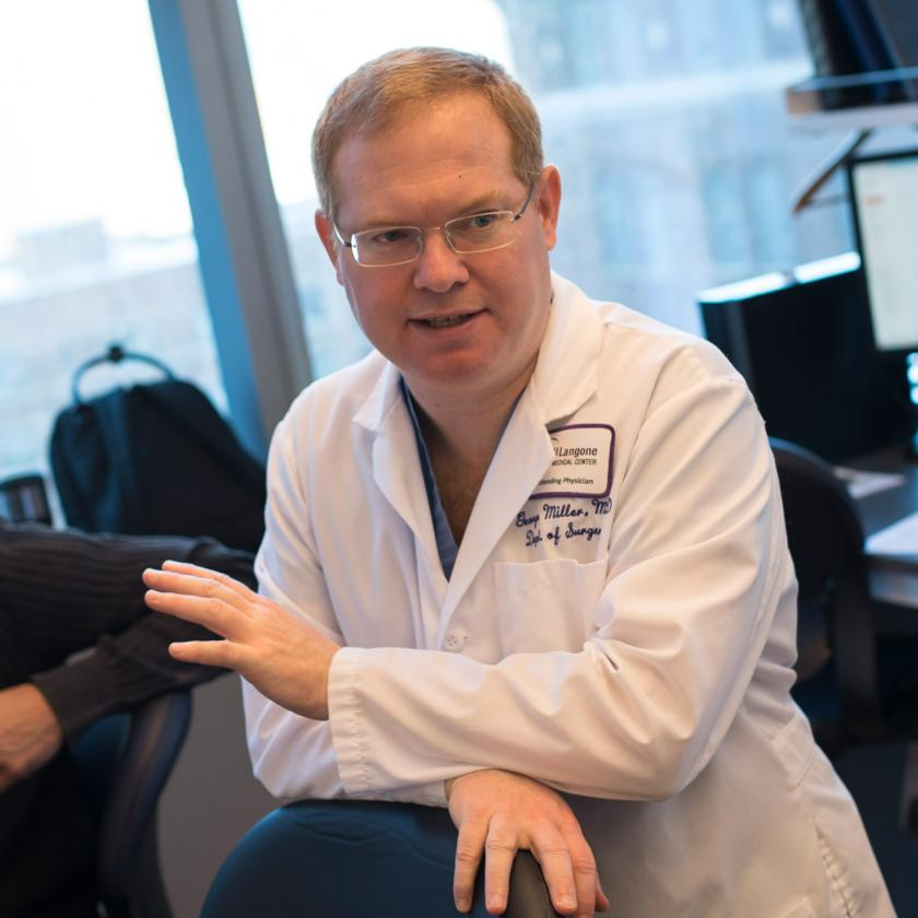 Surgical oncologist, George Miller, MD, in a lab